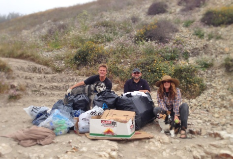 Ranger and his pals help with a monthly clean up at Davenport Beach.